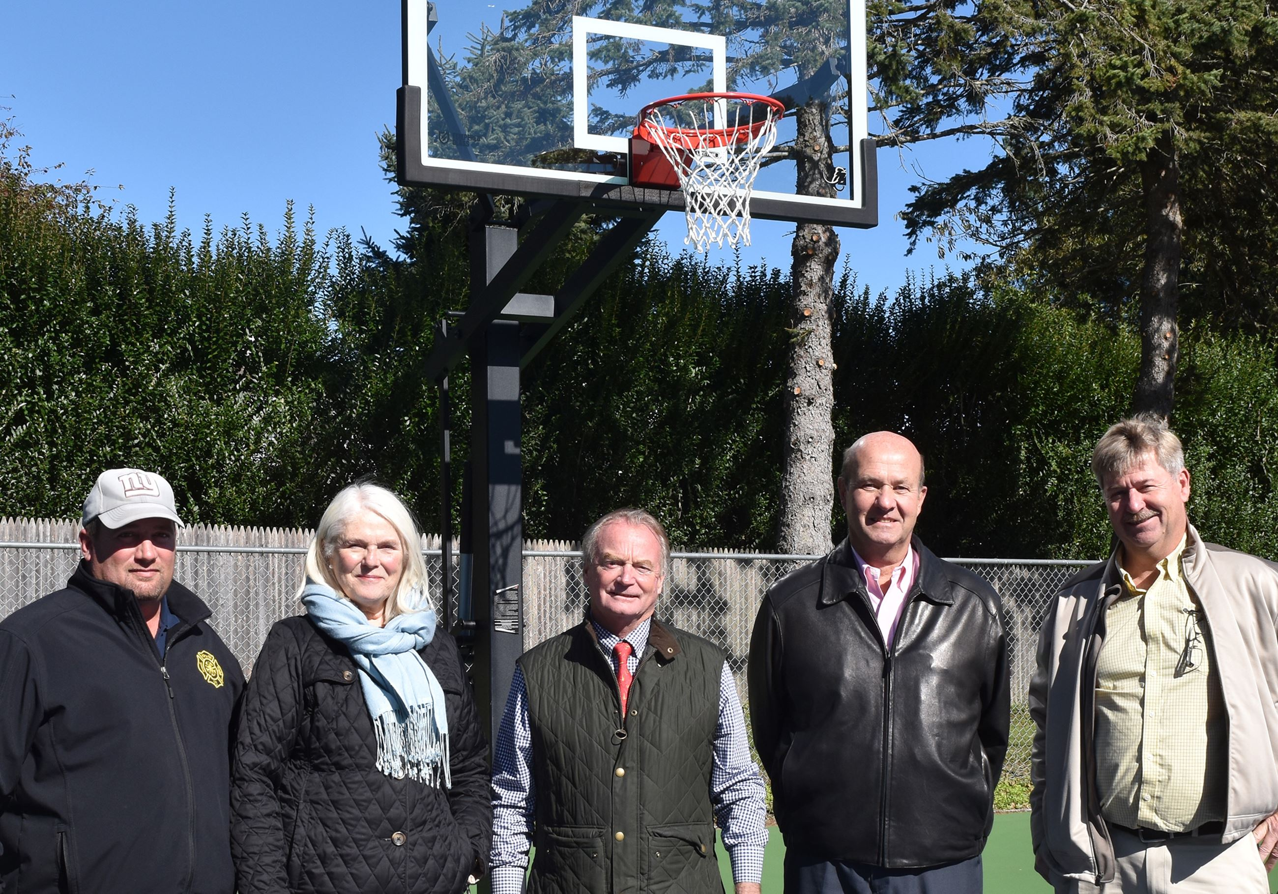 Image of Lola Prentice basketball court opening group photo