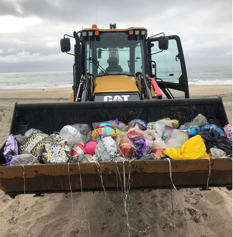 Image of balloons on the beach